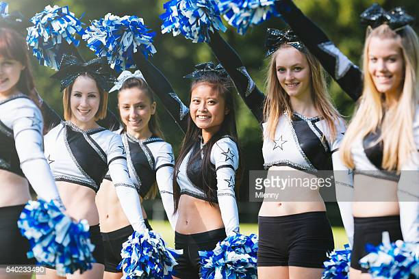 cheerleader group with pom-pom together - cheerleaders stock photos and pictures