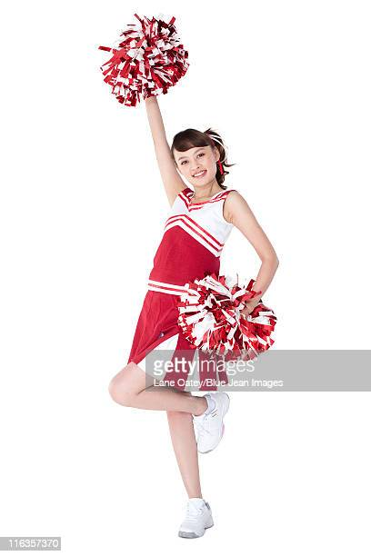 cheerleader in action with her pom-poms - cheerleader up skirt stock photos and pictures