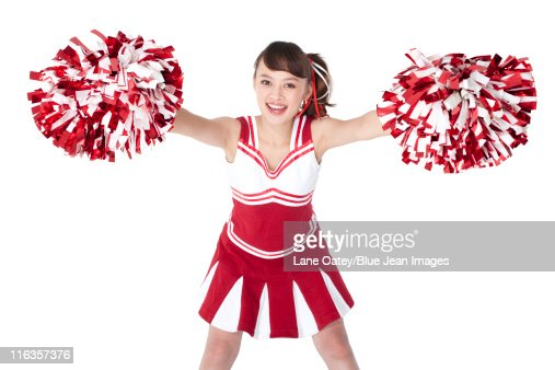 cheerleader in action with her pompoms stock foto getty images. Black Bedroom Furniture Sets. Home Design Ideas