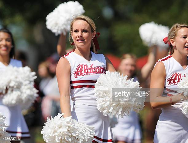 cheerleader in homecoming parade - alabama cheerleaders stock photos and pictures