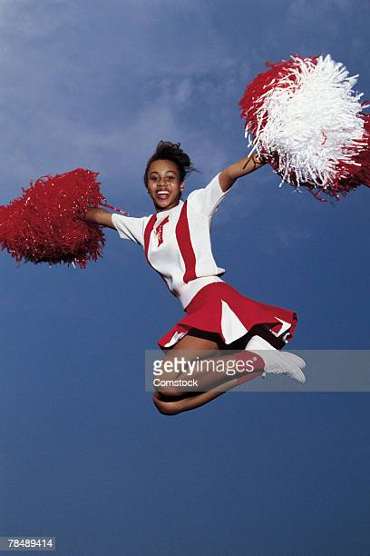 cheerleader in mid-air - black cheerleaders stock photos and pictures