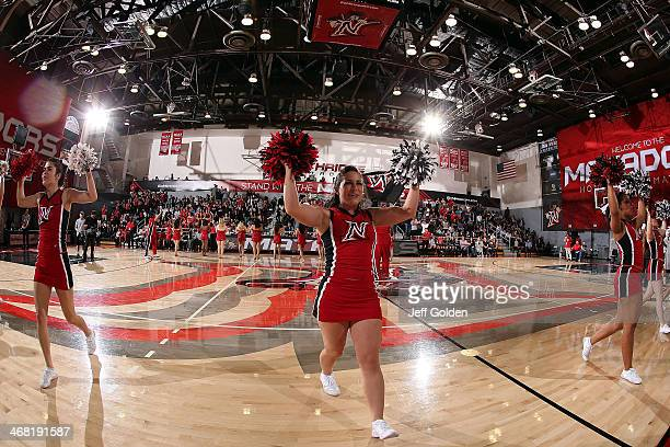 Cheerleader Jayme Shipe and Katie Rodriguez of the Cal State Northridge Matadors perform with team members using pompoms during a timeout against the...