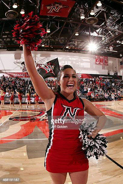 Cheerleader Jayme Shipe of the Cal State Northridge Matadors performs with pompoms during a timeout against the UC Santa Barbara Gauchos in the...