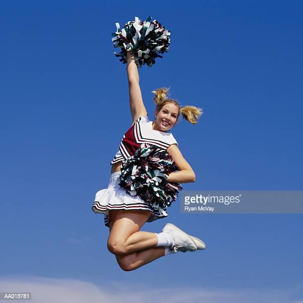 cheerleader jumping - equipamento de equipa imagens e fotografias de stock