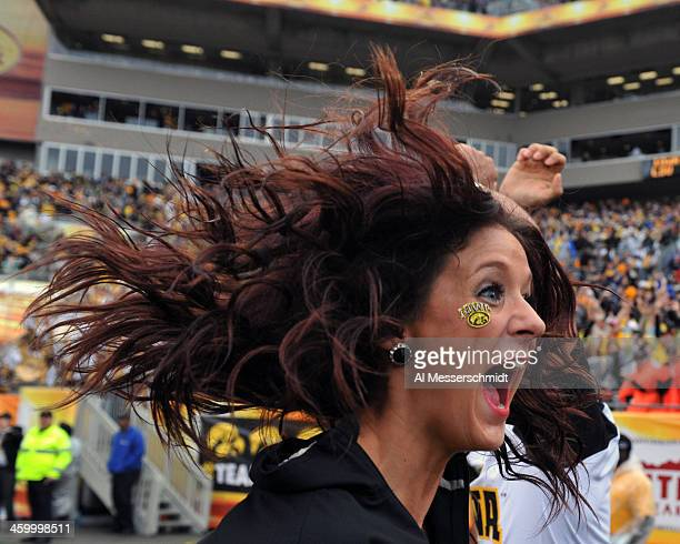Cheerleader Lexie Strom of the Iowa Hawkeyes yells after a secondhalf touchdown against the LSU Tigers January 1 2014 in the Outback Bowl at Raymond...