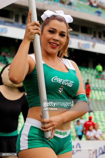 A cheerleader of Santos cheers their team prior to the quarter finals second leg match between Santos Laguna and Tigres UANL as part of the Torneo...