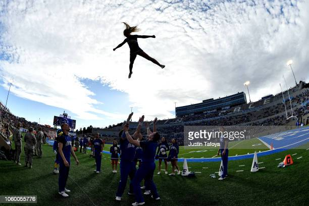 A cheerleader of the Air Force Falcons is thrown in the air during the game against the New Mexico Lobos at Falcon Stadium on November 10 2018 in...
