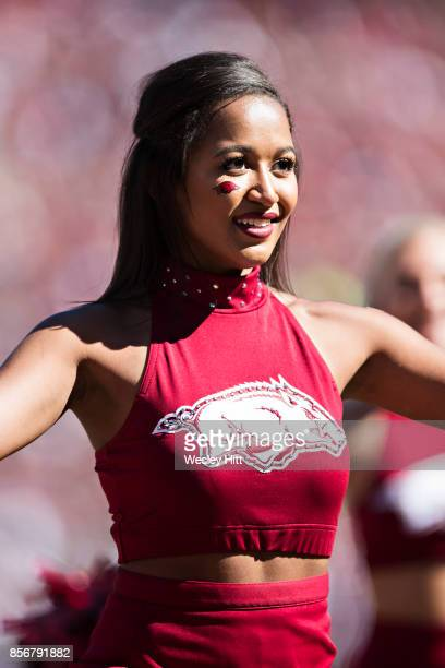 Cheerleader of the Arkansas Razorbacks perform during a game against the New Mexico State Aggies at Donald W. Reynolds Razorback Stadium on September...