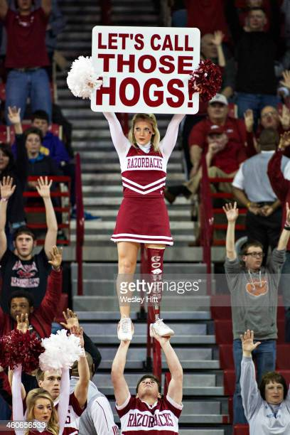 Cheerleader of the Arkansas Razorbacks performs during a timeout against the UTSA Roadrunners at Bud Walton Arena on January 4 2014 in Fayetteville...