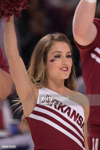 A cheerleader of the Arkansas Razorbacks performs during the game against the North Carolina Tar Heels during the second round of the 2017 NCAA Men's...