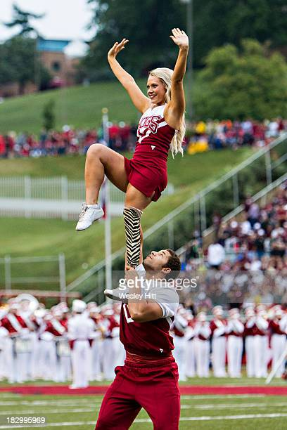 A cheerleader of the Arkansas Razorbacks with a prosthetic leg performs during a game against the Texas AM Aggies at Razorback Stadium on September...