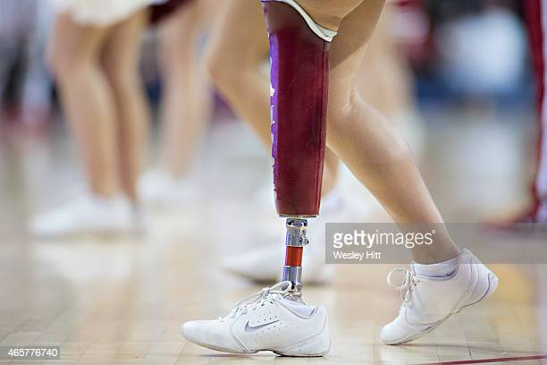 Cheerleader of the Arkansas Razorbacks with a prosthetic leg performs during a timeout against the LSU Tigers at Bud Walton Arena on March 7 2015 in...