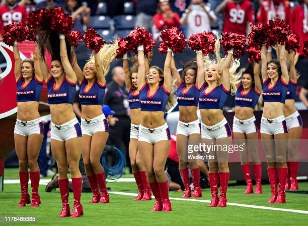 Cheerleader of the Houston Texans enter the stadium before a game against the Oakland Raiders at NRG Stadium on October 27 2019 in Houston Texas