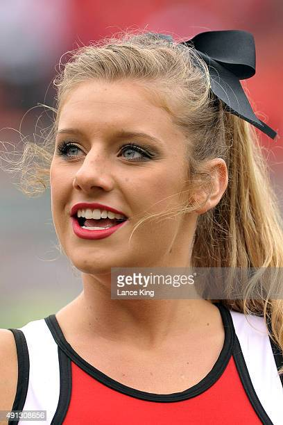 Cheerleader of the North Carolina State Wolfpack performs during their game against the Louisville Cardinals at Carter-Finley Stadium on October 3,...