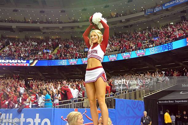 A cheerleader of the Oklahoma Sooners cheers during the Sooners' victory against the Alabama Crimson Tide in the BCS Sugar Bowl on January 2 2014 at...
