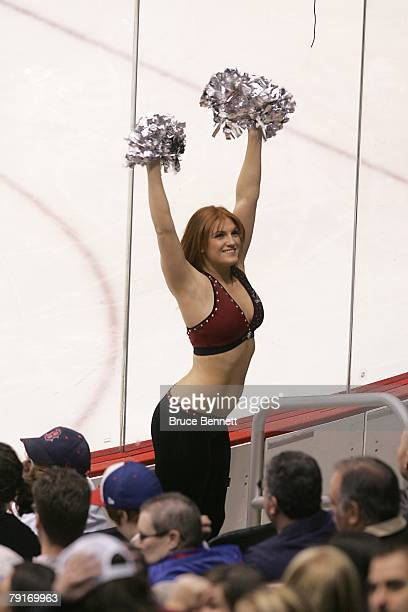A cheerleader of the Phoenix Coyotes rallies the crowd during the NHL game against the Buffalo Sabres at the Jobingcom Arena on January 21 2008 in...