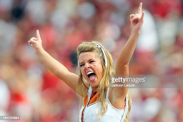 A cheerleader of the Texas Longhorns cheers her team on during their win against the Oklahoma Sooners on October 12 2013 at The Cotton Bowl in Dallas...