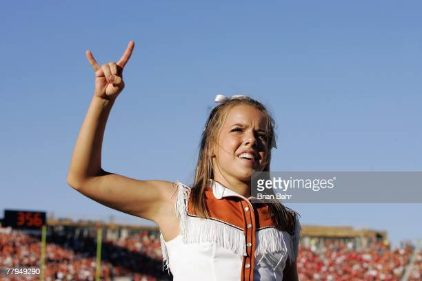 A cheerleader of the Texas Longhorns shows Hook 'em Horns during the game against the Nebraska Cornhuskers at Darrell K RoyalTexas Memorial Stadium...