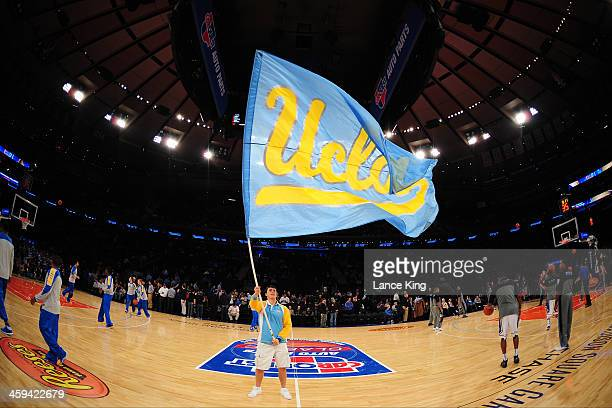 A cheerleader of the UCLA Bruins waves a flag against the Duke Blue Devils during the CARQUEST Auto Parts Classic at Madison Square Garden on...