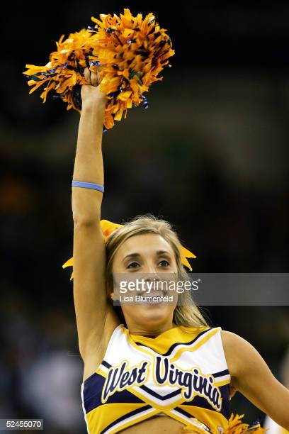 A cheerleader of the West Virginia Mountaineers cheers as her team takes on the Wake Forest Demon Deacons during the second round of the 2005 NCAA...