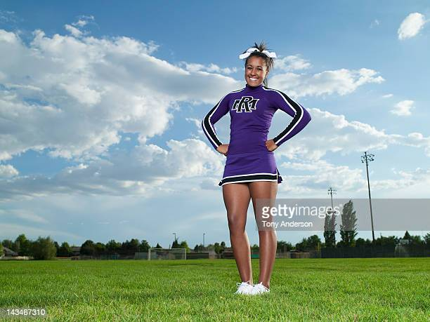 cheerleader on the field - black cheerleaders stock photos and pictures