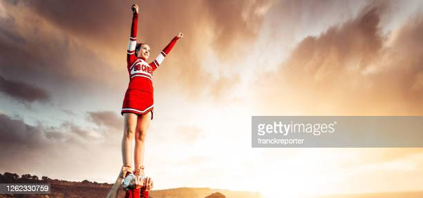 cheerleader on top of the world - cheerleader stock pictures, royalty-free photos & images