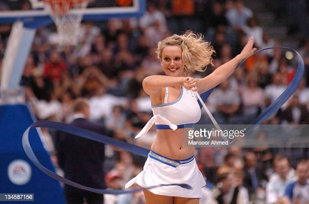 A Cheerleader performs a routine during the NBA Europe Live Tour presented by EA Sports on October 10 2006 at the Koeln Arena in Cologne Germany