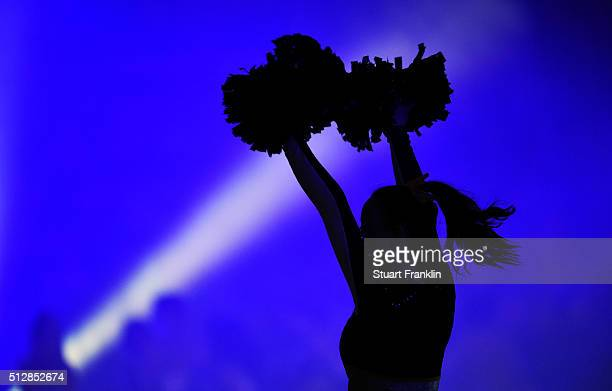 A cheerleader performs during the Bundesliga basketball match between EWE Baskets Oldenburg and Phoenix Hagen at Large EWE Arena on February 26 2016...