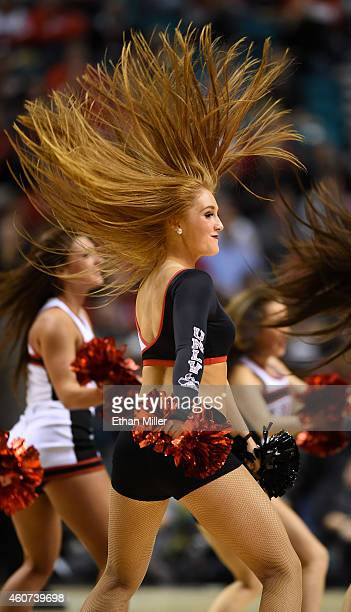 UNLV cheerleader performs during the team's game against the Utah Utes in the 2014 MGM Grand Showcase basketball event at the MGM Grand Garden Arena...