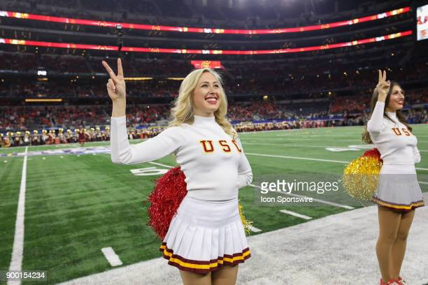 A USC cheerleader performs for the crowd during the Goodyear Cotton Bowl Classic between the USC Trojans and the Ohio State Buckeyes on December 29th...