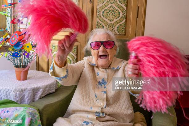 cheerleader pom-pom elderly woman happy - humor imagens e fotografias de stock
