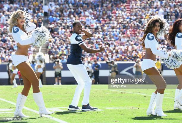 Cheerleader Quinton Peron performs during halftime of the game against the Los Angeles Chargers at Los Angeles Memorial Coliseum on September 23 2018...