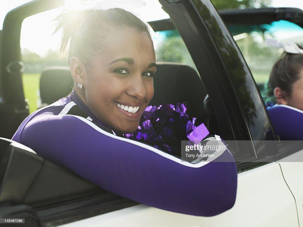 Cheerleader riding in Car : Stock Photo