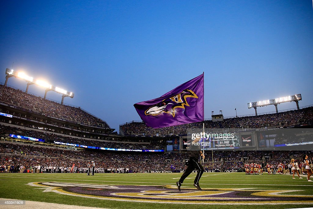A cheerleader runs on the field after the Baltimore Ravens scored against the San Francisco 49ers during the first half of an NFL pre-season game at M&T Bank Stadium on August 7, 2014 in Baltimore, Maryland.