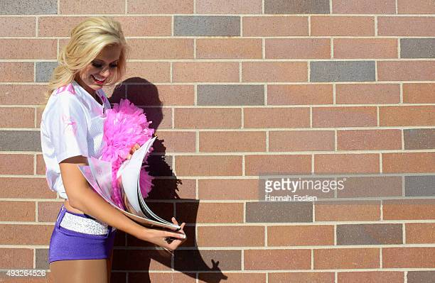 A cheerleader signs an autograph during the third quarter of the game between the Minnesota Vikings and the Kansas City Chiefs on October 18 2015 at...