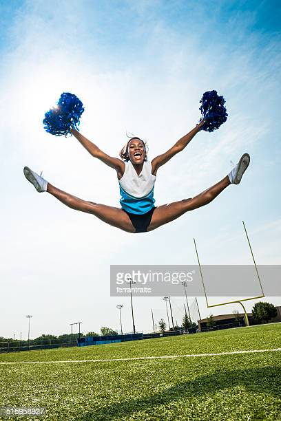 cheerleader split leap - black cheerleaders stock photos and pictures