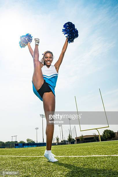 cheerleader split stand - black cheerleaders stock photos and pictures