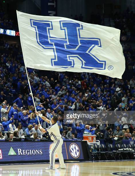 Cheerleader waves a flag prior to the game between the Kentucky Wildcats and the Arkansas Razorbacks during the championship game at the 2017 Men's...