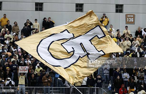 A cheerleader waves the Georgia Tech flag during the game against the Georgia Bulldogs on November 24 2007 at Bobby Dodd Stadium at Historic Grant...