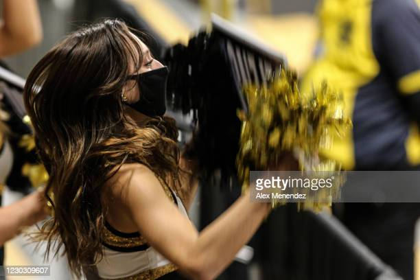 Cheerleader wears a facemask during a NCAA basketball game against the Houston Cougars at Addition Arena on December 26, 2020 in Orlando, Florida.