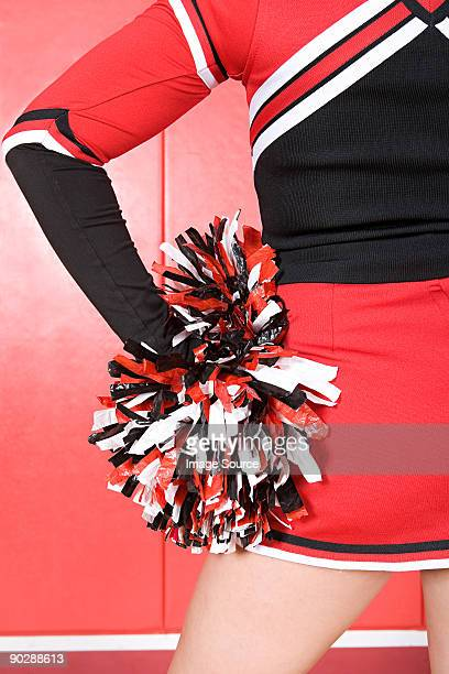 cheerleader with pom pom - cheerleader up skirt stock photos and pictures