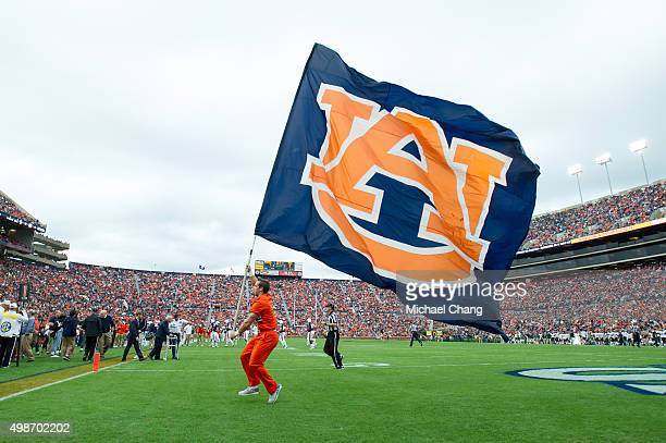 A cheerleader with the Auburn Tigers waves their flag during their game against the Idaho Vandals on November 21 2015 at JordanHare Stadium in Auburn...