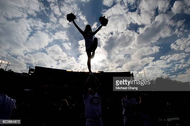 A cheerleader with the Georgia Bulldogs performs prior to their game against the Auburn Tigers at Sanford Stadium on November 12 2016 in Athens...