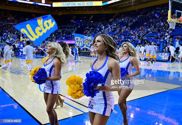 Cheerleaders and banners on the floor before UCLA Bruins played the Arizona State Sun Devils at Pauley Pavilion on February 27 2020 in Los Angeles...