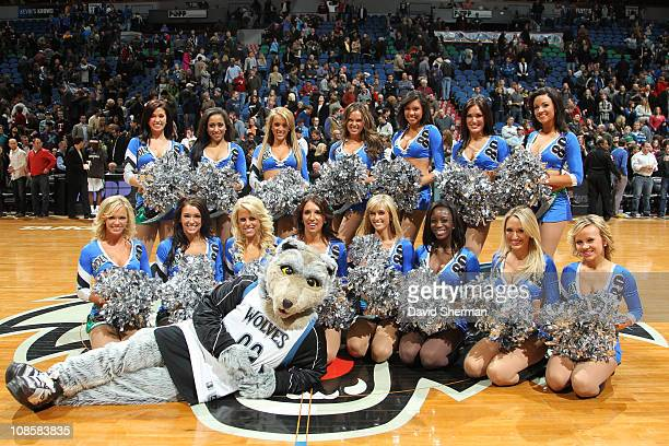 Cheerleaders and Crunch the mascot of the Minnesota Timberwolves pose for a photo after a game against the Toronto Raptors on January 29 2011 at...