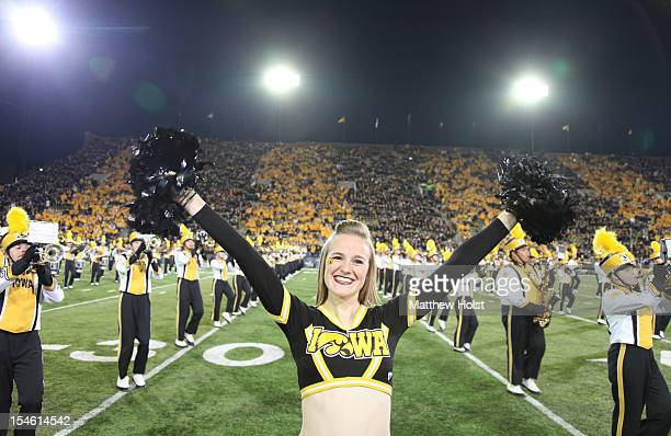 Cheerleaders and marching band members of the Iowa Hawkeyes perform before the matchup against the Penn State Nittany Lions on October 20 2012 at...