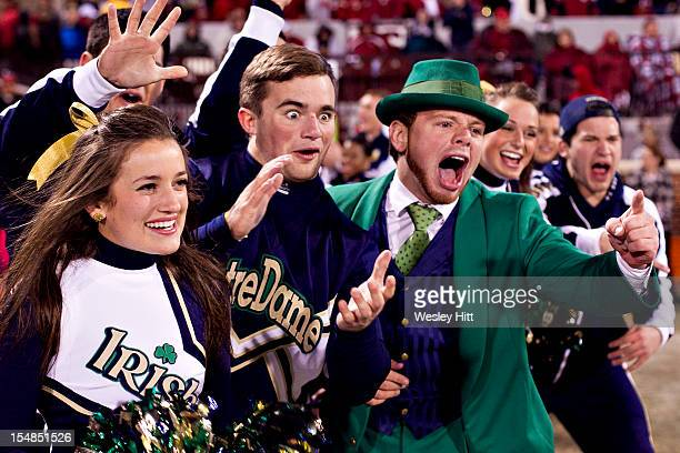 Cheerleaders and Mascot of the Notre Dame Fighting Irish celebrate after a touchdown against the Oklahoma Sooners at Gaylord Family Oklahoma Memorial...