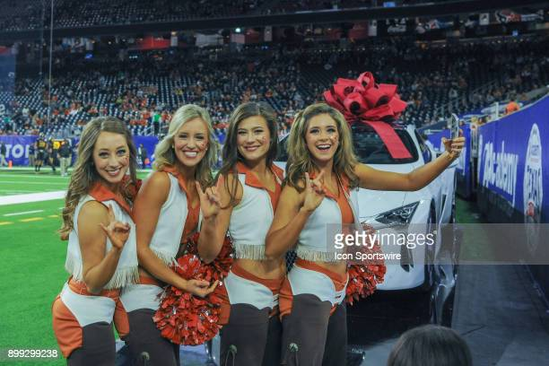 UT cheerleaders and Pom Squad line up for a selfie during the Texas Bowl game between the Texas Longhorns and the Missouri Tigers on December 27 2017...