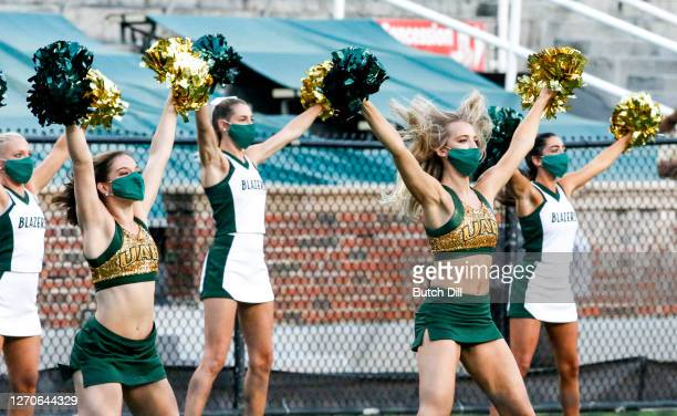 Cheerleaders cheer before the start of an NCAA college football game between UAB and Central Arkansas at Legion Field on September 3, 2020 in...
