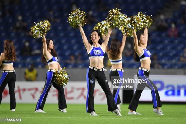 Cheerleaders cheer for Gamba Osaka during the J.League Meiji Yasuda J1 match between Gamba Osaka and Kashima Antlers at Panasonic Stadium Suita on...